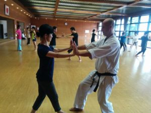 Richard Segissement kyoshi practicing partner walking exercise with seminar participant.