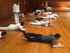 Connected movement training on the floor.